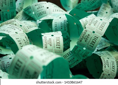 unrolled roll of green raffle tickets
