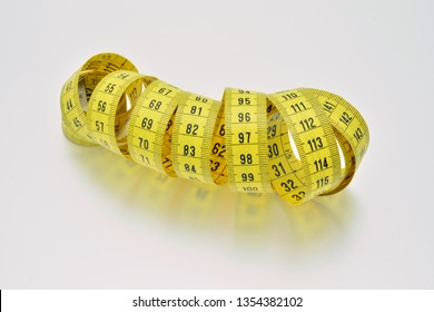 Unrolled yellow tape measure