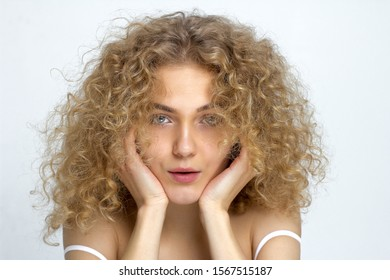 Unruly hair. A woman with curly hair