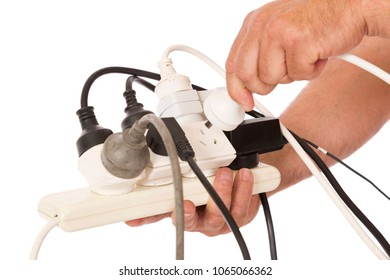 Unsafe use of double adaptor to supply power to domestic equipment.