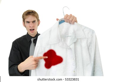 Unsatisfied customer holds up a dry cleaned suit. Missed a spot!