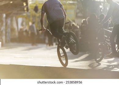 Unseen bmx rider balancing on one wheel