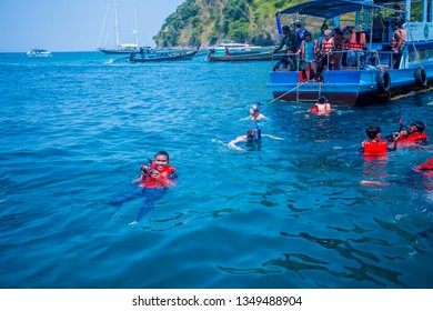 UNSEEN KRABI THAILAND-March 2019:tourists taking group your happy swimming at railea beach Island krabi THAILAND.