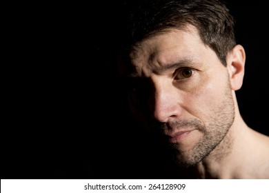 Unshaven Man With Half Face In shadow