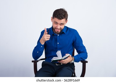Unshaven man sitting with a notebook