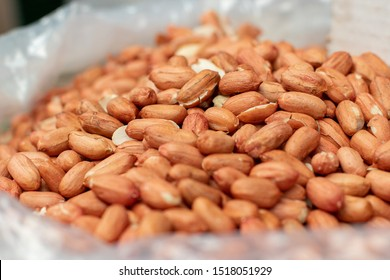 unshelled peanuts in a polythene bag on the market