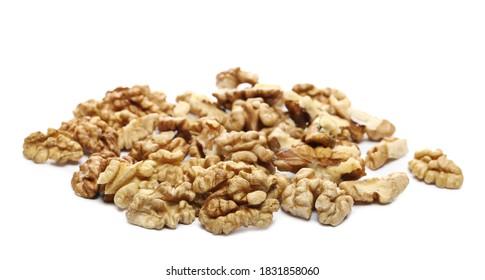 Unshelled walnuts pile isolated on white background