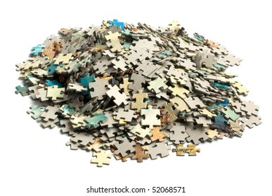 unsolved bunch of jigsaw puzzles pieces isolated on white