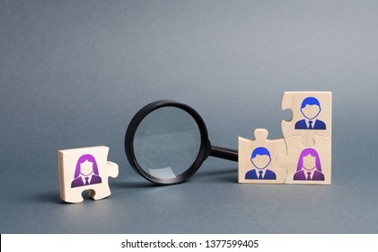 Unsorted team puzzle and magnifying glass. Search, recruitment staff, hiring leader. Lack of specialists in the labor market. Creating an efficient and productive business unit
