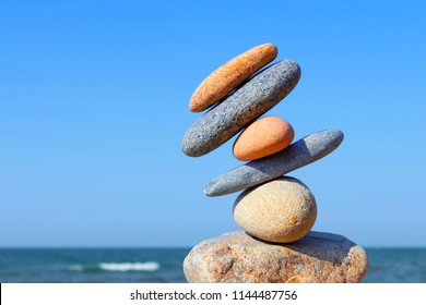 Unstable construction of multi-colored stones. The disturbed equilibrium. Imbalance concept.