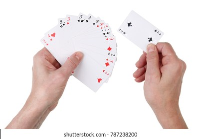 Unsuccessful deal in a card game concept. An elderly male player holds the smallest cards at face value. Isolated on white with patch top view studio shot