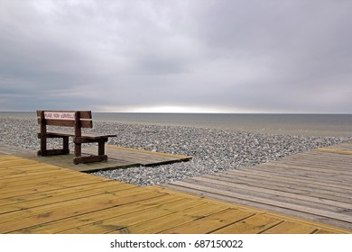 Unsupervised beach, Hauts-de-France (North, France). A bench facing the sea