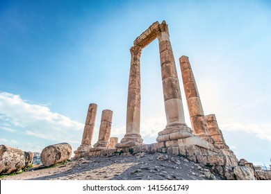 unsurpassed view of the ruins of the temple of Hercules on the top of the mountain of the Amman citadel against the background of a blue sky with clouds