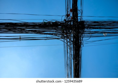 unsystematic and tangle of power cord wire and communication cable in Bangkok, Thailand.