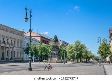 Unter den Linden boulevard in the central Mitte district of Berlin with the equestrian statue of King Frederick II of Prussia and  linden trees  lining the pedestrian mall on the median