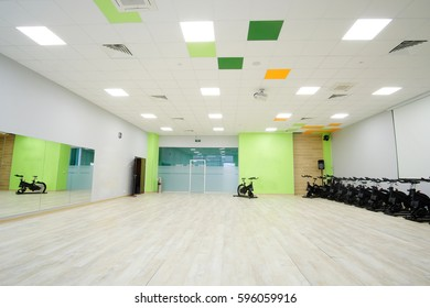 Unterior of a fitness hall with sport bikes