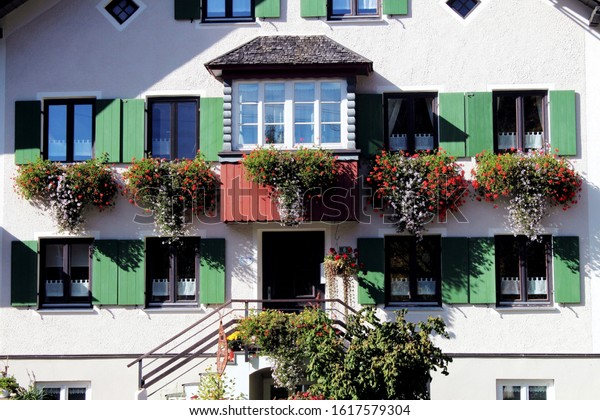 Unterjoch, Germany - October 13, 2019: Traditional flower-bedecked building in the bavarian countryside. Unterjoch is a village in the Allgäu with agriculture and hiking tourism.