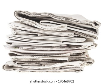 untidy pile of old folding newspapers on white background