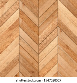 Untreated light parquet floor with herringbone pattern. Wood texture for background. Wooden wall made of thin planks.