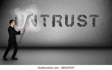 Untrust word painting on gray wall