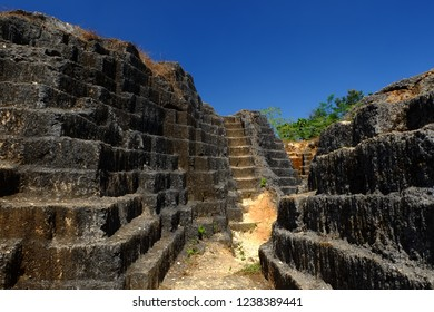 Unused limestone quarries under the blue sky. Attractive carved remains of limestone miners in Yogyakarta-Indonesia.