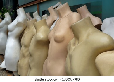 Unused mannequin body. Naked manequins in second hand shop. The scrap of naked body model for cloth fashion on the street shop.