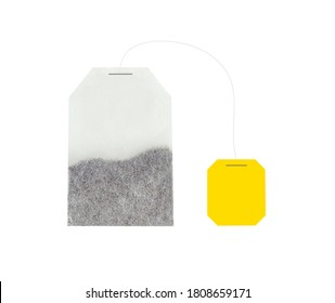 An unused, new tea bag with a string label. Template, template for design. Yellow tag. Tea leaves. One portion for preparing a hot drink.