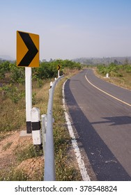 Unused road to border crossing in Thailand, showing Cambodian mountains in background.