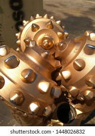 Unused well drilling rotary bit close up.