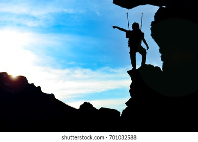 unusual adventurous guy in the mountains
