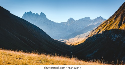 Unusual alpine range in sunlight. Location Juta village - Chaukhebi, Georgia country, Europe. Main Caucasian ridge. Adventure vacation. Scenic image of hiking concept. Discover the beauty of earth.