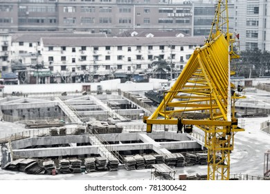 Unusual angle, close-up view at yellow crane boom at construction site in China