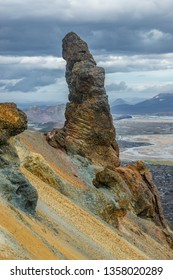 Unusual awkward even comic rock formation as a erected phallus in volcanic mountains Landmannalaugar in Iceland, summer time, dramatic view