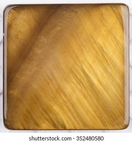 unusual beautiful natural light ocher brown pearl, pearl with iridescent tints in the form of a square plate for mosaic