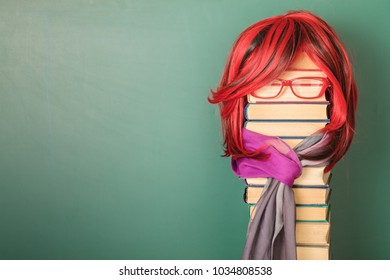 Unusual Beautiful Teacher Girl with Luxurious Red Hair. Copy space on blackboard