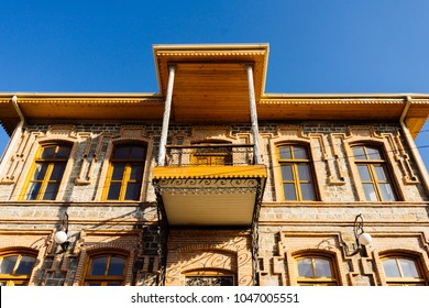 unusual beautiful urban architecture, ancient building against the blue sky