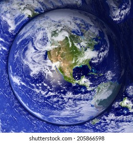 Unusual button Earth day planet ocean background. Elements of this image furnished by NASA.