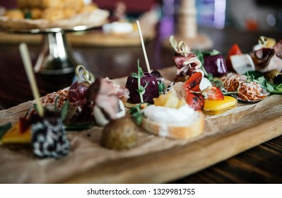 unusual canapes with berries, cheese, potatoes, fish, sesame and greens, photos for the restaurant menu