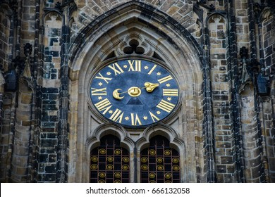 the unusual clock of the cathedral of St Vitus in Prague, a church with dark Gothic towers guarded by gargoyle: this church is the main religious symbol of the Czech Republic