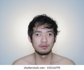 unusual closeup of man squint on white background