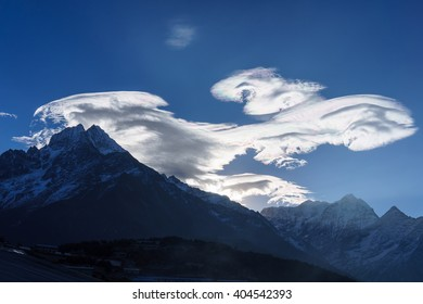 Unusual cloud formations over Thamserku mountain, Namche Bazaar, Everest region, Nepal
