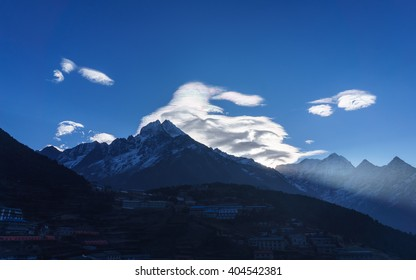 Unusual cloud formations at sunrise over Thamserku mountain, Namche Bazaar, Everest region, Nepal