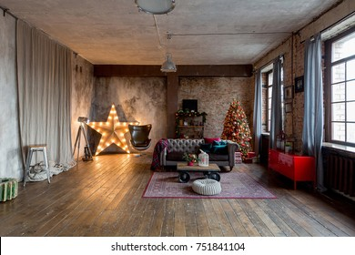 unusual dark interior of the living room in the loft style is decorated with a Christmas tree