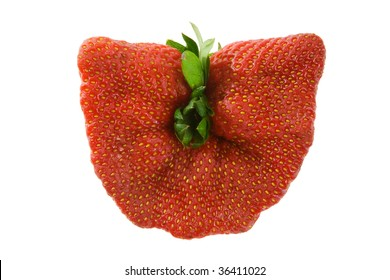 Unusual deformed strawberry isolated over white background.