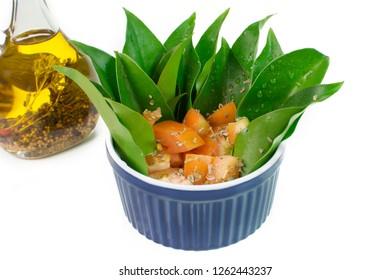 Unusual edible plant Pereskia aculeata, called in Brazil as ora-pro-nóbis salad in white background close