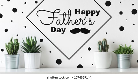 Unusual Happy Father's day Background. Crazy Cactus Father day greeting card. Potted cactus house plants on white shelf Fathers day web banner.