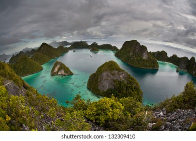 The unusual limestone islands of Wayag in northern Raja Ampat, Indonesia are incredibly beautiful.  They harbor a gorgeous set of hidden bays, beaches, and even marine lakes.