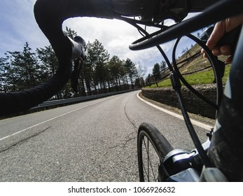Unusual low angle view of a cyclist training on a sunny spring day