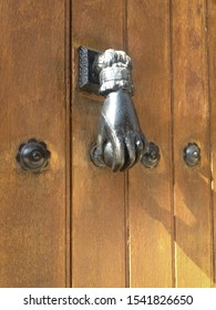 Unusual metal hand door knocker / knob in spain