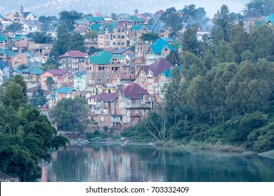 Unusual shaped rooftops on the houses reflecting in the water of lake Kivu. Indicative of the Democratic Republic of the Congo. Bukavu on the southern shore of Lake Kivu